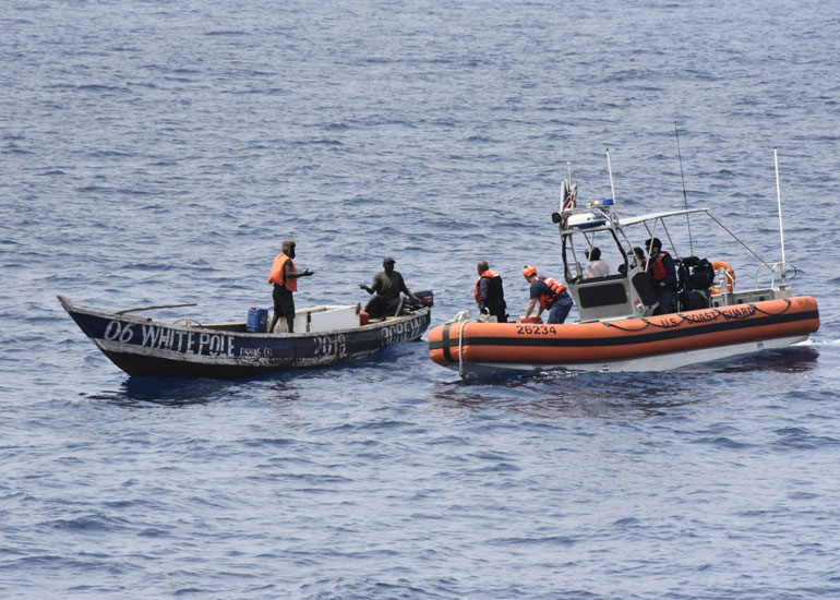 USCGC THETIS boatcrew approach a vessel Thursday, March 14, 2019 to determine if they were in any distress along the West African Coast. Thetis crewmembers spotted people on the vessel waving an orange object signalling the cutter. (USCG photo by Jonathan Lally)